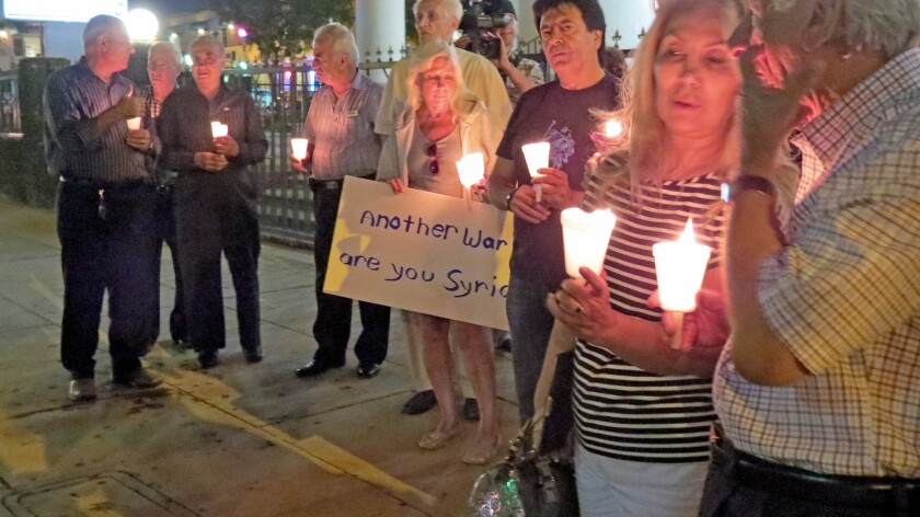 Vigil against Syrian involvement draws more than 200 protesters in Glendale