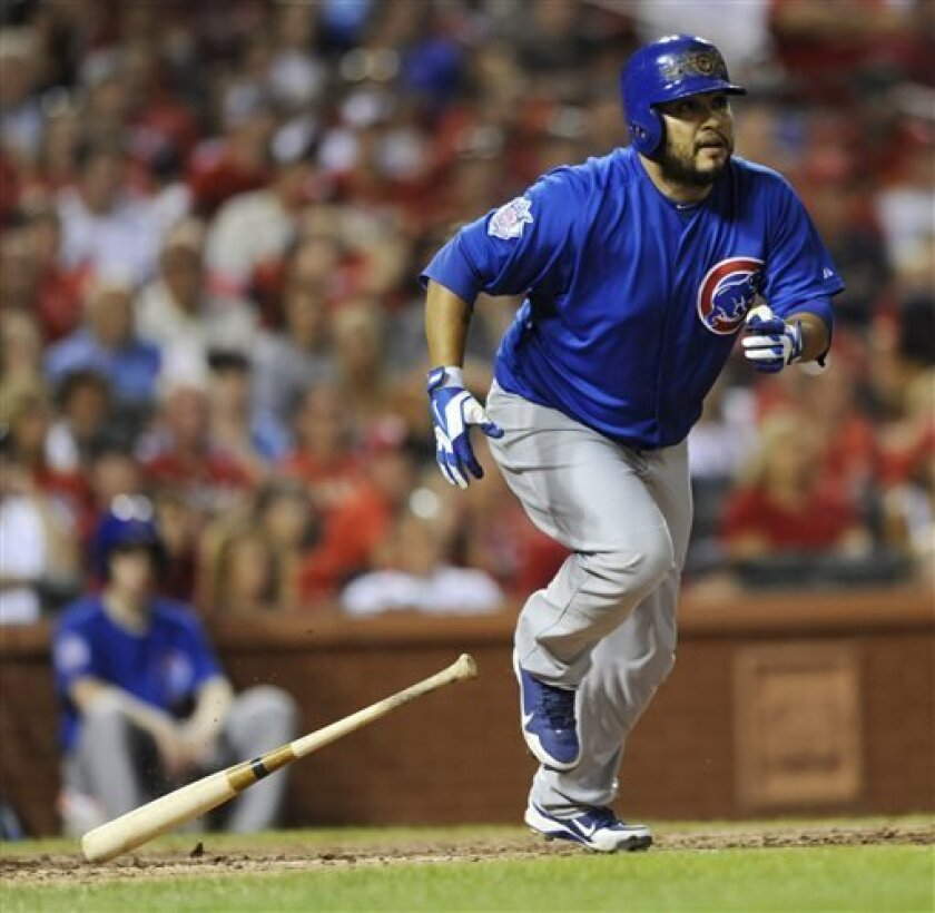 Chicago Cubs' Dioner Navarro watches his RBI double against the St. Louis Cardinals in the eighth inning in a baseball game Saturday, Aug. 10, 2013, at Busch Stadium in St. Louis. (AP Photo/Bill Boyce)