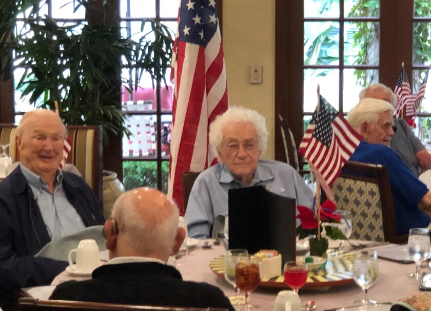 La Vida Del Mar resident John Campbell, 99, (left) is believed to be the oldest Pearl Harbor survivor in San Diego.