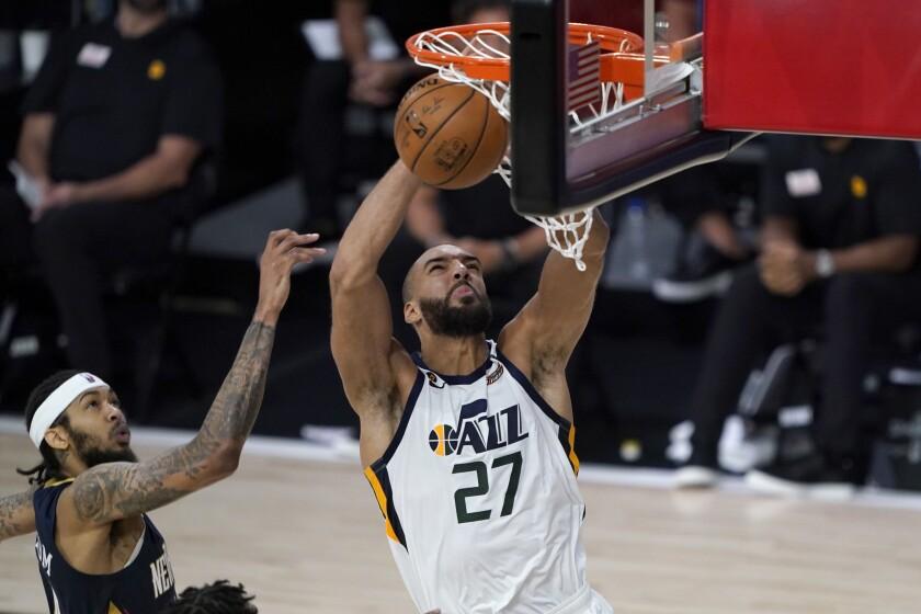 Utah Jazz's Rudy Gobert (27) heads to the basket past New Orleans Pelicans' Brandon Ingram.