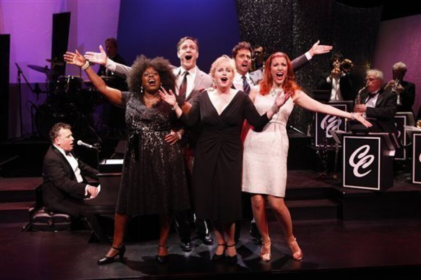 """In this theater publicity image released by Karen Greco PR, from left, Billy Stritch (at piano,) Lillias White, Howard McGillin, Sally Mayes, David Burnham and Rachel York, in a scene from """"The Best Is Yet To Come: The Music of Cy Coleman,"""" performing as part of Americas Off Broadway at 59E59 Theaters in New York. (AP Photo/Carol Rosegg)"""