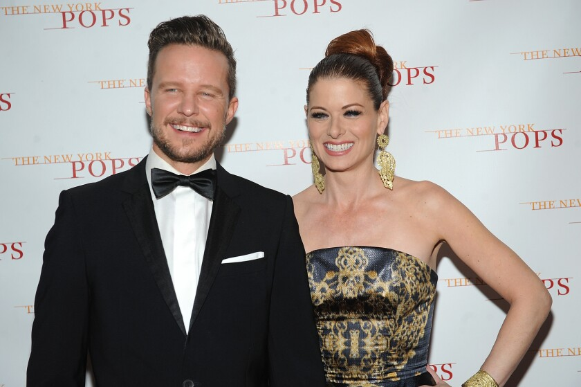 Actors Will Chase and Debra Messing have split up.