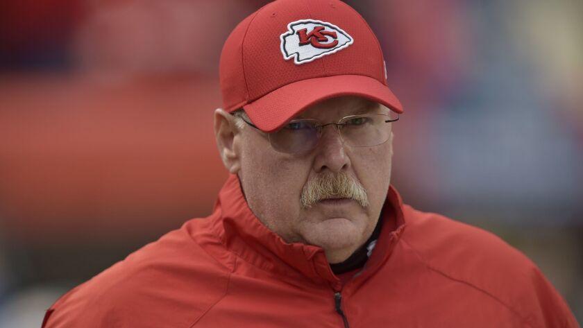 Kansas City Chiefs head coach Andy Reid watches warm ups before an NFL football game against the Cle