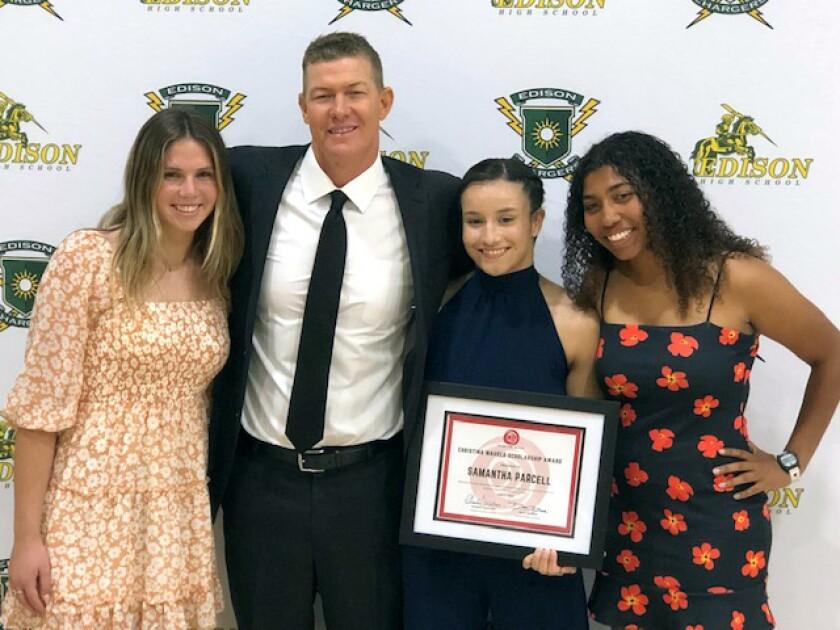 Matt Mauser, presenter of the inaugural Christina Mauser Scholarship, with Sophia Drake, Samantha Parcell and Taya Riley.