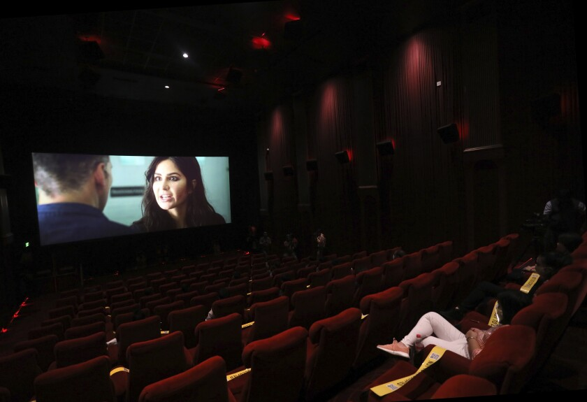 Moviegoers watch a Bollywood film in New Delhi, India, after cinemas reopened in much of the country in October.