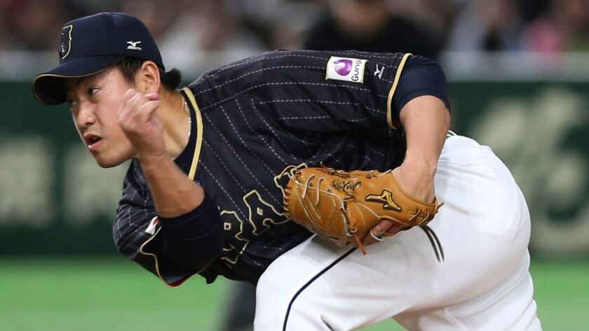Japan's closer Kazuhisa Makita pitches against Australia in the ninth inning of their first round game of the World Baseball Classic at Tokyo Dome in Tokyo, Wednesday, March 8, 2017.