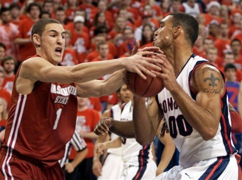 Gonzaga's Robert Sacre, right, struggles for a loose ball with Washington State's Klay Thompson in the first half of their NCAA college basketball game at McCarthey Athletic Center in Spokane, Wash., Wednesday, Dec 2, 2009. (AP Photo/Rajah Bose)