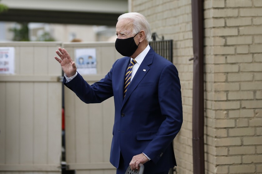 Democratic presidential candidate, former Vice President Joe Biden waves as he arrives to meet with with small business owners, Wednesday, June 17, 2020, at Carlette's Hideaway, a soul food restaurant, in Yeadon, Pa. (AP Photo/Matt Slocum)