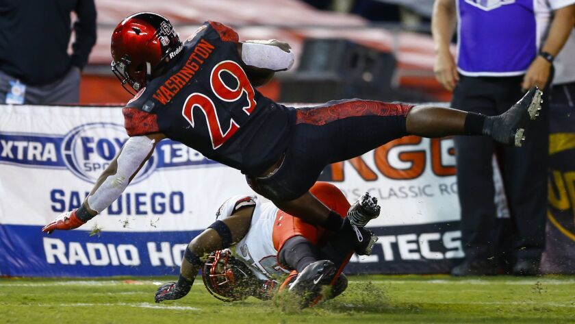 SDSU running back Juwan Washington (29) is tackled short of the goal line late in the second quarter against UNLV.