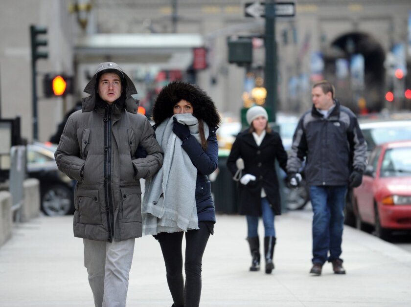 Benedikt Vom Orde and Julia Felte, tourists from Essen, Germany, walk along Park Avenue in New York during a bitter cold spell, Saturday, Feb. 13, 2016. Bitter temperatures and biting winds had much of the northeastern United States bundling up for the some of the worst cold of the winter — a snap