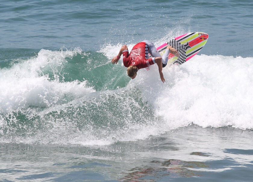 San Clemente's Kolohe Andino goes backside off the top of a wave during round three of the Men's US Open of Surfing on Thursday.