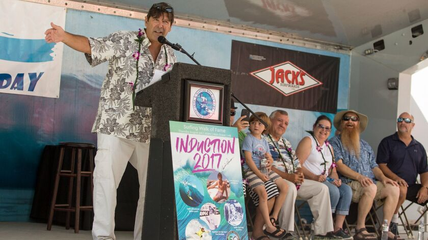 Andy Verdone speaks Thursday during the Surfing Walk of Fame induction ceremony, where he and four o