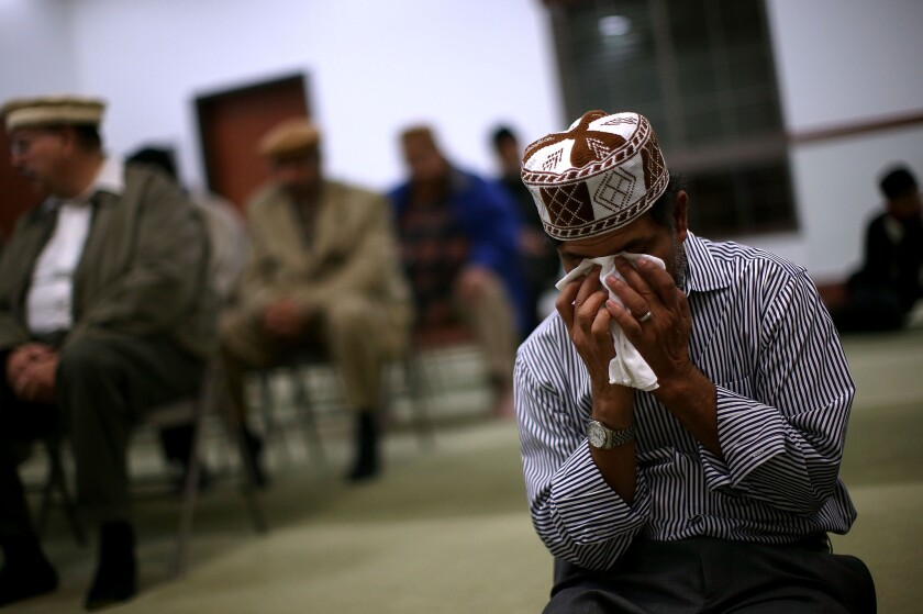 A man prays at a mosque in Chino following the San Bernardino shooting.