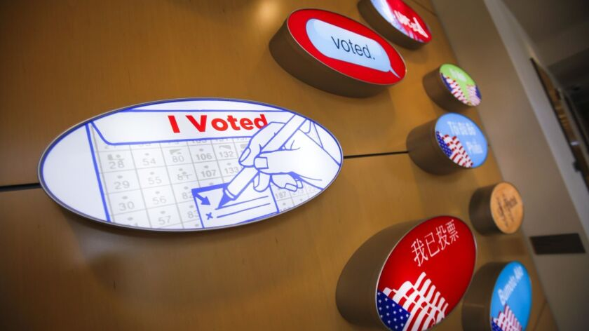 A display of I Voted in different languages signs is on display at the San Diego County Registrar of Voters office.