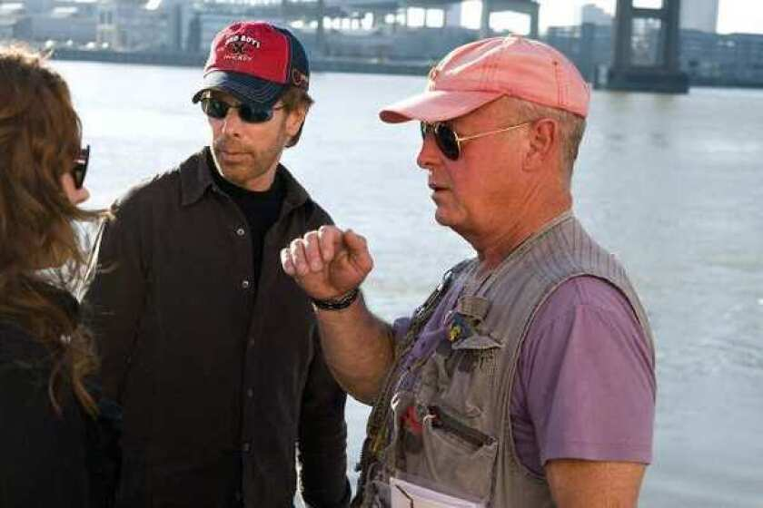 "Tony Scott, right, with Jerry Bruckheimer on the set of ""Deja Vu"" in New Orleans in 2006."