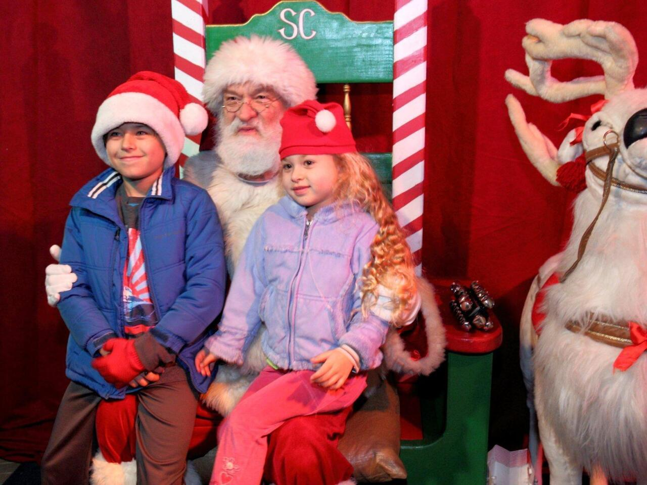 Aidan and Ava Farmer visit with Santa
