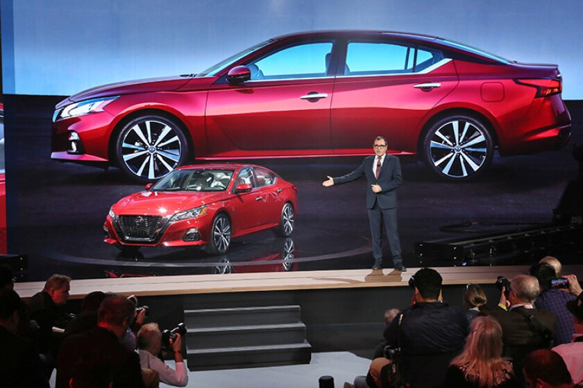 Denis Le Vot, senior vice president and chairman of the management committee for Nissan North America, unveils the all-new 2019 Nissan Altima at the New York International Auto Show on March 28, 2018. The all-new sixth generation Altima celebrates 25 years of sales and adds available all-wheel drive, ProPILOT Assist technology and a segment-exclusive variable- compression turbocharged engine. (Photo/Stuart Ramson for Nissan Motor Co.)