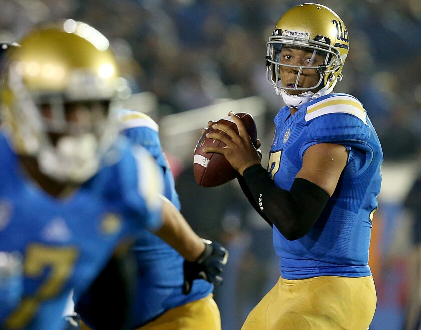 Time Warner Cable has added new channels showcasing Pac-12 Conference sports available to subscribers in Los Angeles. Pictured: UCLA quarterback Brett Hundley leads the Bruins against Cal on Oct. 12, 2013, at the Rose Bowl in Pasadena.