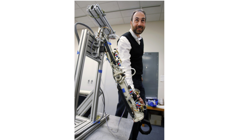 Ryan Calo, now a law professor at the University of Washington, stands with a robot at Stanford University in 2009. He specializes in the laws governing robotics.