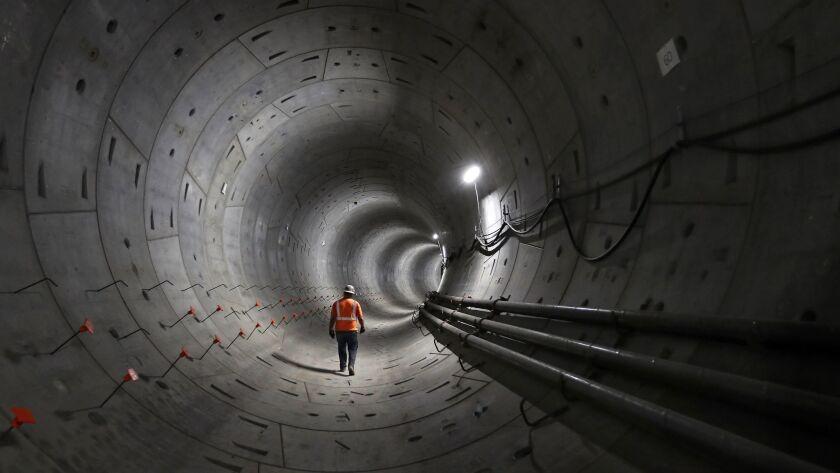 LOS ANGELES, CA-MAY 14, 2018: Miner Jesus Ruiz walks inside a tunnel that is part of the 1.9 mile u