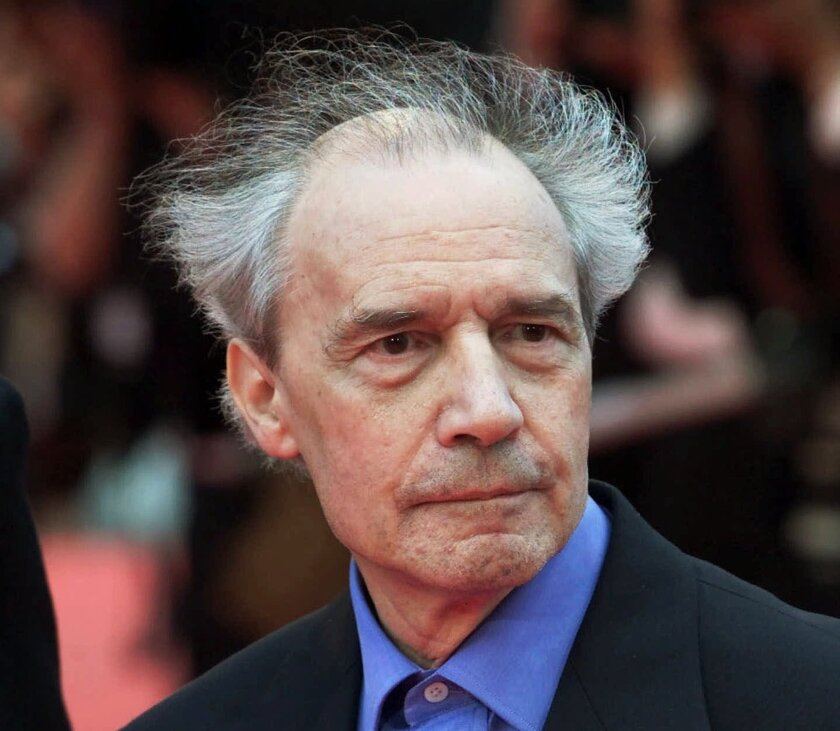 """FILE - This Wednesday, May 16, 2001 file picture shows French director Jacques Rivette arriving for the screening of his film """"Who Knows"""", in competition at the Film Festival in Cannes, France. French director Jacques Rivette, a secretive pioneer of convention-bashing New Wave film who brought renown to women actors such as Emmanuelle Beart, has died at 87. (AP Photo/Michel Euler, File)"""