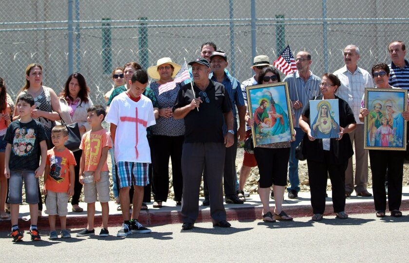 In this file photo, members of San Diego's Chaldean community gathered at the Otay Detention Center to pray and protest for Iraqi Christians who fled ISIS. They are in custody at the Otay Detention Center after Crossing US-Mexico Border.  Photo by John Gastaldo/U-T San Diego/Zuma Press