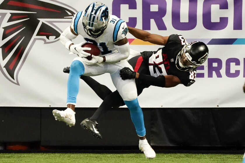 Carolina Panthers strong safety Juston Burris (31) picks off the ball intended for Atlanta Falcons wide receiver Russell Gage (83) in the end zone during the second half of an NFL football game, Sunday, Oct. 11, 2020, in Atlanta. (AP Photo/John Bazemore)