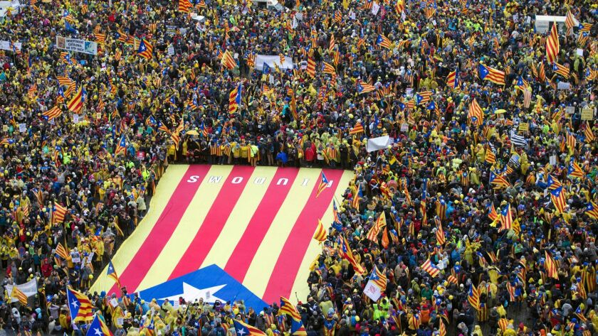 Pro-independence Catalan supporters gather to begin a demonstration near the EU quarter in Brussels on Thursday , Dec. 7, 2017. Thousands of Pro-Catalan supporters rallied in Brussels two weeks before Spanish regional elections.