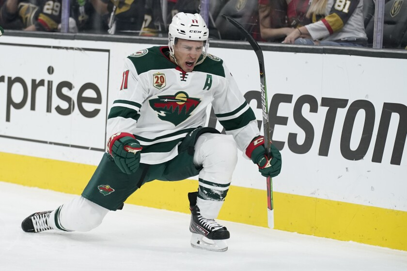 Minnesota Wild left wing Zach Parise (11) celebrates after scoring against the Vegas Golden Knights during the first period of an NHL hockey game Monday, May 24, 2021, in Las Vegas. (AP Photo/John Locher)