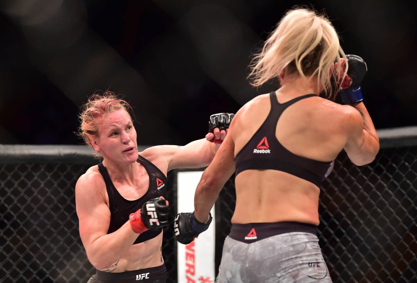 Feb 3, 2018; Belem, Brazil; Valentina Shevchenko (red gloves) fights Priscila Cachoeira (blue gloves) during UFC Fight Night at Mangueirinho Arena. Mandatory Credit: Jason Silva-USA TODAY Sports ** Usable by SD and OS ONLY **