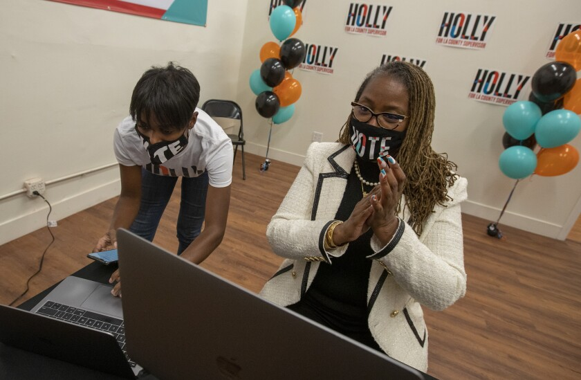 State Sen. Holly Mitchell, right, and campaign manager Lenee Richards watch election results Tuesday night.