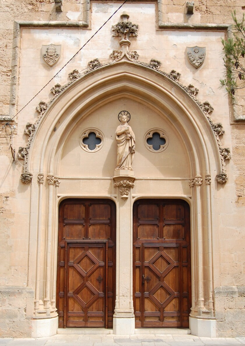 The entrance to San Pere church, said to be where Junipero Serra was baptized in Petra, Mallorca, his birthplace.