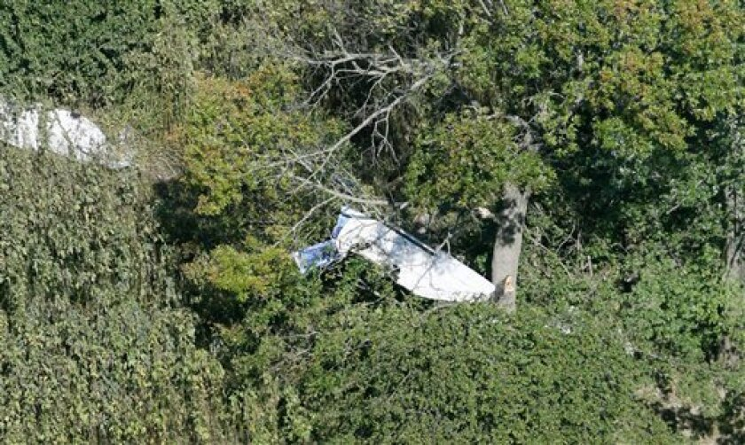 A single engine plane is seen after it crashed in Albany, Ind., Wednesday, Sept. 30, 2009. The pilot became unresponsive and the plane started to speed up and slow down at dangerous speeds, officials said. The pilot may have had a health problem or have been suffering from a lack of oxygen, officials said. (AP Photo/The Star Press, Jeri Reichanadter from WTHR Chopper 13)