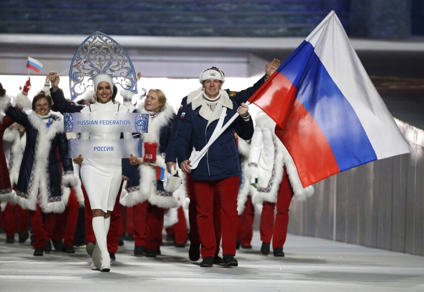 Alexander Zubkov of Russia carries the national flag as he leads the team during the opening ceremony of the 2014 Winter Olympics in Sochi, Russia.