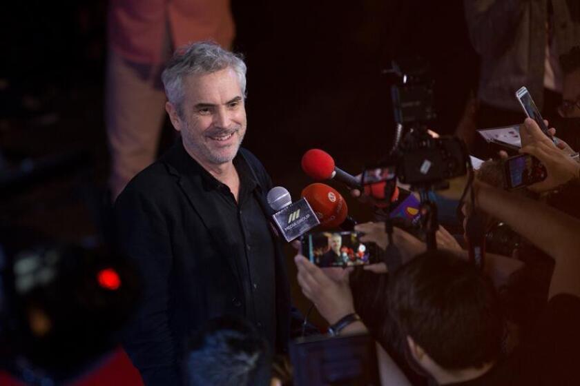 El cineasta mexicano Alfonso Cuarón habla con los medios de comunicación. EFE/Archivo