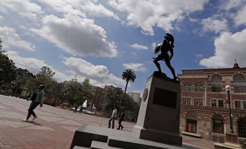 LOS ANGELES, CALIF. - MAY 26, 2018. The statue of Tommy Trojan looks up at cloudy skies from his pe