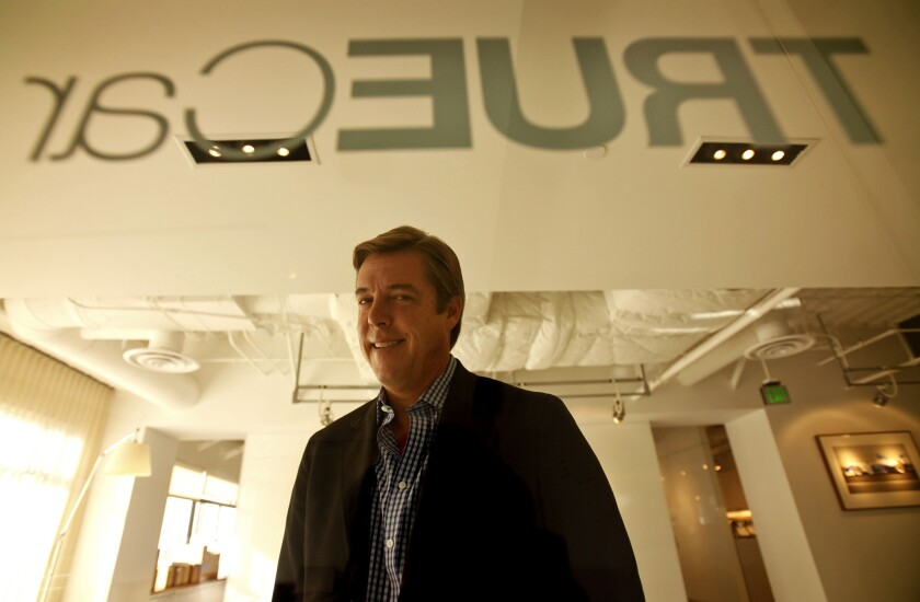 Scott Painter is founder and CEO of TrueCar Inc. A California auto dealers group has filed a lawsuit against the Santa Monica car sales service company, claiming its business model violates state regulations.