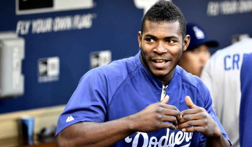 Center fielder Yasiel Puig and the Dodgers arrive at the stretch run in first place in the NL West.