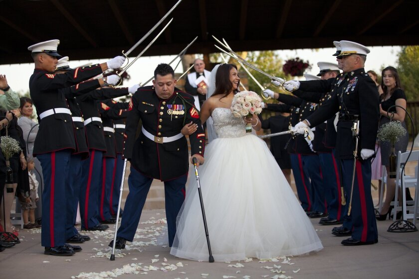 Juan Dominguez, a triple amputee, and his wife Alexis have a belated wedding ceremony April 27, 2013, in Temecula. Dominguez was wounded as a lance corporal in Sangin, Afghanistan in 2010 while deployed with the 3rd battalion, 5th Marine Regiment. He medically retired from the Corps as corporal.