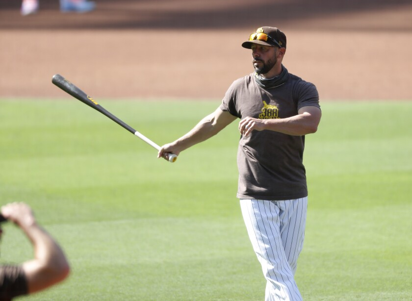 Padres manager Jayce Tingler hits a ball during a practice
