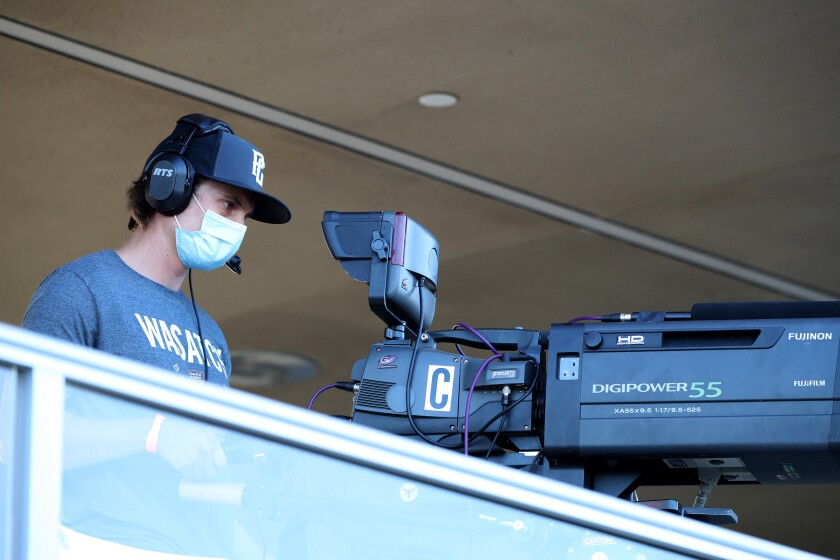 Camera operators wear masks for the Orange County Soccer Club home match against the Phoenix Rising on Thursday.