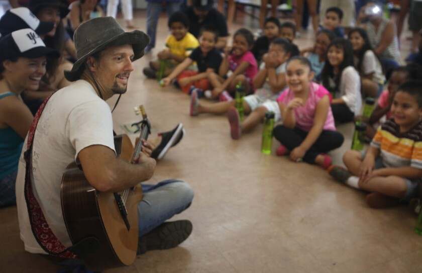 Jason Mraz is shown performing for children at Burbank Elementary School in San Diego.