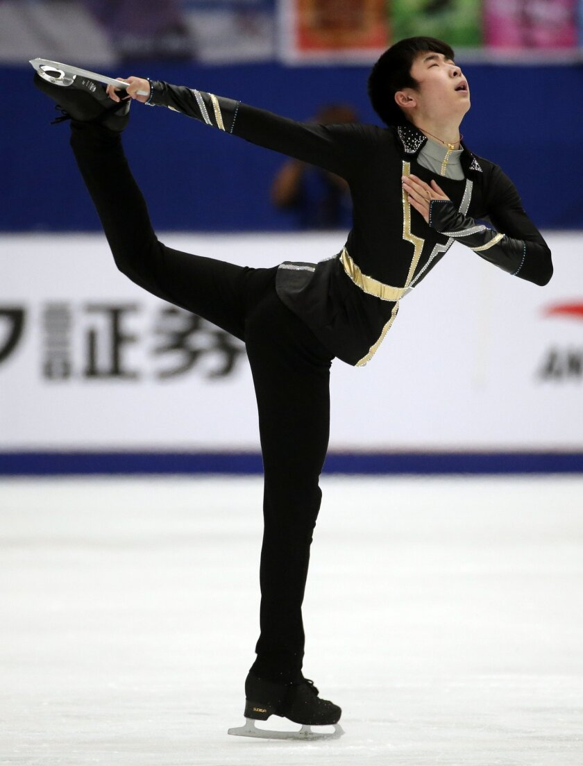 China's Jin Boyang competes in the Mens Free Skating program during the ISU Grand Prix of Figure Skating at the Capital Gymnasium in Beijing, China, Saturday, Nov. 7, 2015. (AP Photo/Mark Schiefelbein)