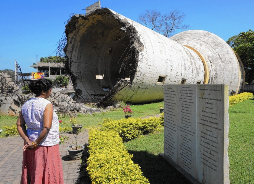 A water tank destroyed in the Sri Lankan civil war now stands as a memorial in Kilinochchi, along the A9 highway that links southern Sri Lanka with the northern areas that were the main battlegrounds of the conflict. (Shashank Bengali/ Los Angeles Times)