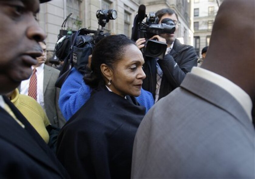 Baltimore Mayor Sheila Dixon leaves the courthouse after being convicted on a single charge she took gift cards intended for the city's poor, Tuesday, Dec. 1, 2009, in Baltimore. Although Sheila Dixon was acquitted of a felony theft charge, her conviction could force her from office. (AP Photo/Rob Carr)