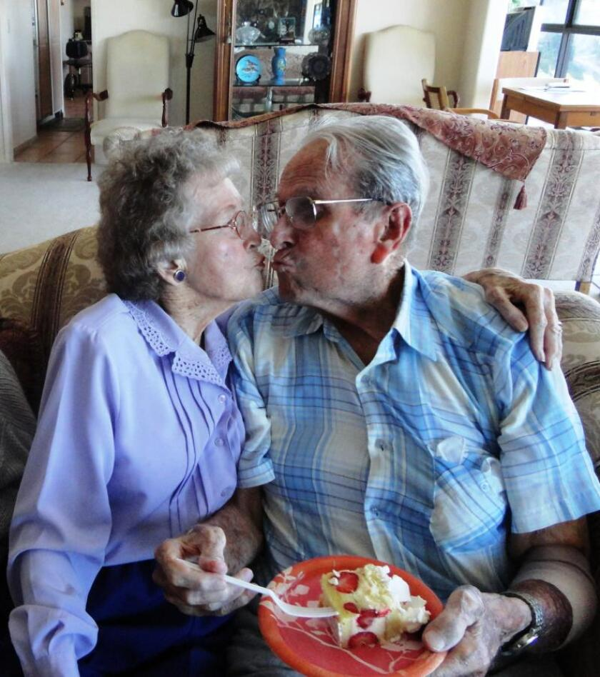 Residents share a moment at the Butterfly Gardens assisted-living home.