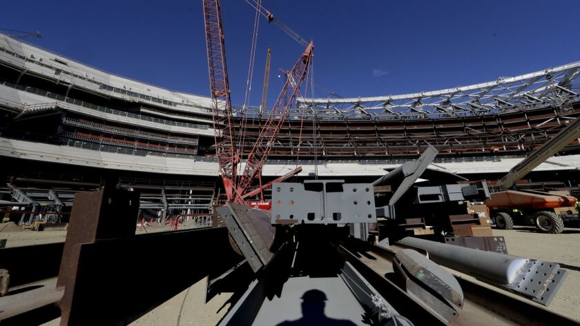 A large crane looms over LA Stadium on Tuesday, Sept. 18, 2018, in Inglewood, Calif. The new facilit