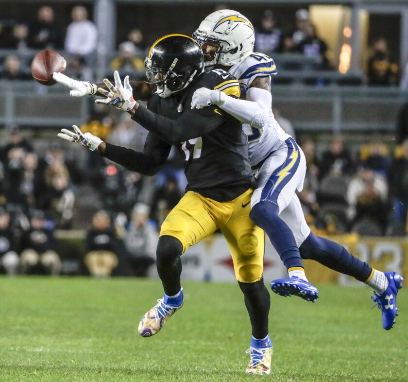 Chargers cornerback Michael Davis is called for pass interference as he breaks up a pass intended for Pittsburgh Steeers receiver JuJu Smith-Schuster during a second quarter drive at Heinz Field on Sunday.