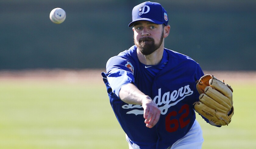 Dodgers pitcher Louis Coleman warms up during a spring training baseball workout on Feb. 22 in Glendale, Ariz.
