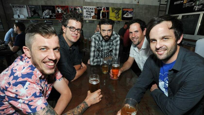 Members of Hills Like Elephants are (l-r) Sean Davenport, Bobby Roquero, Michael Alan Hams, Andrew Armerding and Gregory Thielmann. Some of them are drinking Plenty for All Pilsner at Fall Brewing. (Rick Nocon/ For The San Diego Union-Tribune)